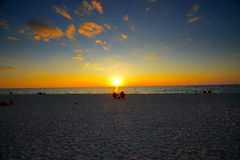Merida Beach Florida. Gorgeous sunset on Merida Beach Florida. Couple sitting in chairs in the distance as a silhouette Stock Images