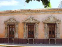 Merida city aged facade in Mexico. Golden color Royalty Free Stock Photos