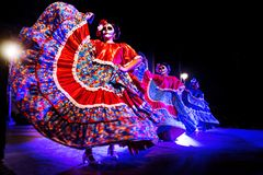 Dancing Catrinas with skull make up for dias de los muertos with traditional dresses at Remate de Paseo Montejo, Merida stock images
