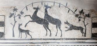 Hunting scene mosaic with dogs and deers. National Museum of Roman Art in Merida, Spain. Merida, Spain - September 4th, 2018: Hunting scene mosaic with dogs and stock photo