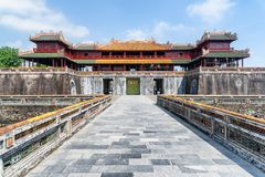 The Meridian Gate to the Imperial City in Hue, Vietnam. The Meridian Gate on blue sky background in Hue, Vietnam. The main gate to the Imperial City with the stock images