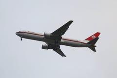 Meridiana Airlines Boeing 767 descending for landing at JFK International Airport in New York. NEW YORK - SEPTEMBER 27, 2015: Meridiana Airlines Boeing 767 Stock Photos