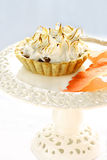 Meringue apple tart on a white cake stand Stock Photos