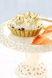 Meringue apple tart on a white cake stand Stock Photos