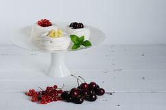 Meringue baked with red fruits and pineapple. royalty free stock photography
