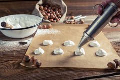 Meringue on baking paper for macaroons Stock Photography