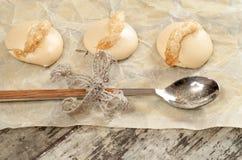Meringue on baking paper Royalty Free Stock Image