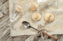 Meringue on baking paper Royalty Free Stock Photo