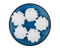 Meringue in blue glass plate isolated on white Stock Image
