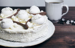 Meringue cake and a cup of coffee Stock Photos