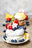 Meringue cake decorated with fresh fruits Stock Image