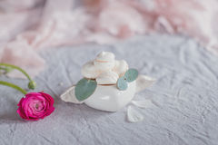 Meringue cake and flowers in vase. Meringue cake on the table in a vase and flowers Stock Photo