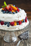 Meringue cake with fresh berries. Royalty Free Stock Photography