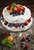 Meringue cake with fresh berries. Royalty Free Stock Photos