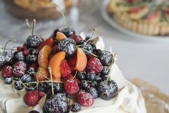 Meringue cake with fruits and berries royalty free stock photography