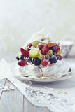 Meringue Cake with Fruits and Coconut royalty free stock photos