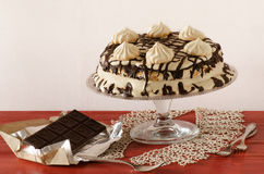 Meringue cake with mascarpone cream and chocolate Royalty Free Stock Images