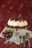Meringue Cake Pavlova with cream, berries  and mint, bokeh background Royalty Free Stock Photo