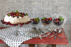 Meringue Cake Pavlova with cream, berries  and mint Stock Image