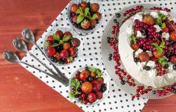 Meringue Cake Pavlova with cream, berries  and mint Stock Photography