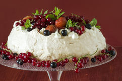 Meringue Cake Pavlova with cream, berries  and mint Stock Photos