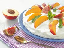 Meringue cake. Traditional Pavlova dessert with fruits. Selective focus. stock image