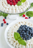 Meringue cakes with blueberries and raspberries Stock Photography
