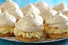 Meringue cakes with cream. Stock Image