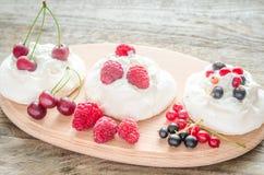 Meringue cakes with fresh berries Stock Photo