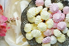 Meringue cakes and lace Royalty Free Stock Photos
