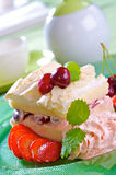 Meringue with cherry. Light meringue with cherries and cream Stock Photography