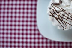 Meringue with chocolate stripes on a ceramik bowl royalty free stock image
