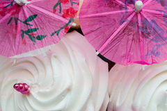 Meringue Cocktail Umbrella (1). Pink Cocktail Umbrellas with White Meringues Royalty Free Stock Images