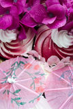 Meringue Cocktail Umbrella (2). Pink Cocktail Umbrellas with White Meringues and Purple Flowers Royalty Free Stock Images