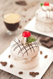 Meringue with coffee cream. Royalty Free Stock Photography