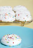 Meringue cookie on a blue plate royalty free stock images