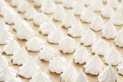 Meringue cookies on baking paper ready to bake on the table. Step by step recipe of meringue close up Stock Images