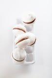 Meringue cookies with chocolate on white background. Meringue cookies with chocolate on white Stock Photo