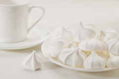 Meringue cookies and coffee Royalty Free Stock Image