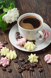 Meringue cookies and coffee cup Stock Image