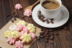 Meringue cookies and coffee cup Stock Images