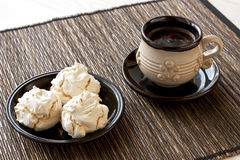 Meringue cookies and cup of aromatic coffee Stock Image