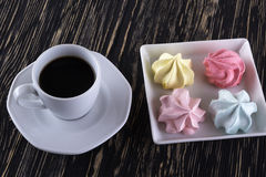 Meringue Cookies and cup of coffee. Royalty Free Stock Photo
