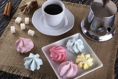 Meringue Cookies and cup of coffee. Stock Photo