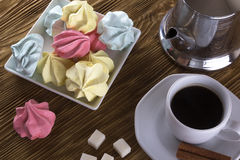 Meringue Cookies and cup of coffee. Stock Images