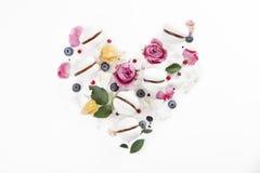 Meringue cookies in heart shape with flowers and blueberries. Meringue cookies in heart shape with flowers and blueberry Stock Photos