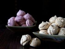 Meringue cookies pink and light brown. Meringue cookies in raspberry and mocha flavor Royalty Free Stock Photos