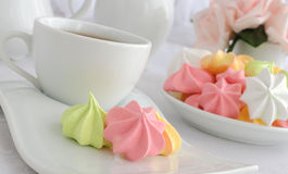 Meringue cookies on a plate with a cup of coffee Royalty Free Stock Photos