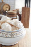 Meringue cookies in a vase on a wooden cutting board. Still life Royalty Free Stock Photos