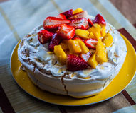 Meringue. Delicious dessert with strawberries and mango Royalty Free Stock Images